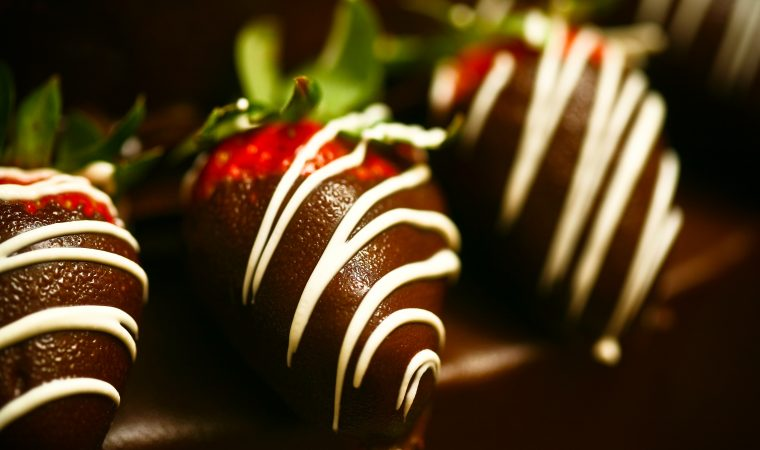 A row of chocolate covered strawberries.